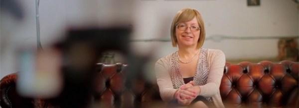 A still of a woman on a couch in I Am, an LGBT+ short film