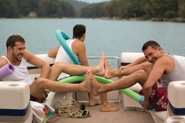 Three gay men on a boat in shorts overcoming some boundaries with long distance relationships