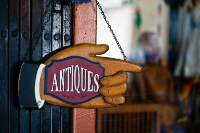 the national antiques art and vintage fair with an antiques sign