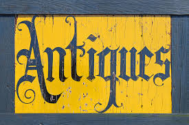 An antiques sign like the national antiques art and vintage fair might have