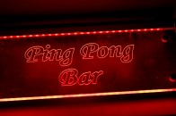 A glowing red sign saying ping pong bar from Yamamori Sushi, who's manager Graham Ryan we interviewed in this month's Amuse Bouche