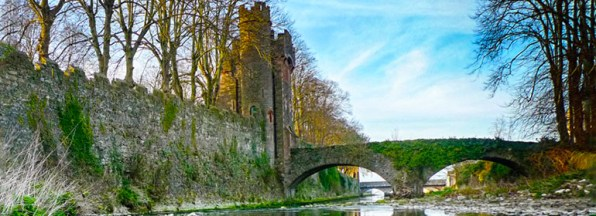 A castle and bridge over a river outside one of the Irish Landmark Trust venues - the same Irish Landmark Trust who has a Valentine's Giveaway