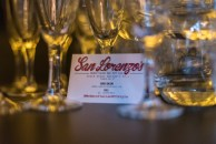 A San Lorenzo's business card and wine glasses