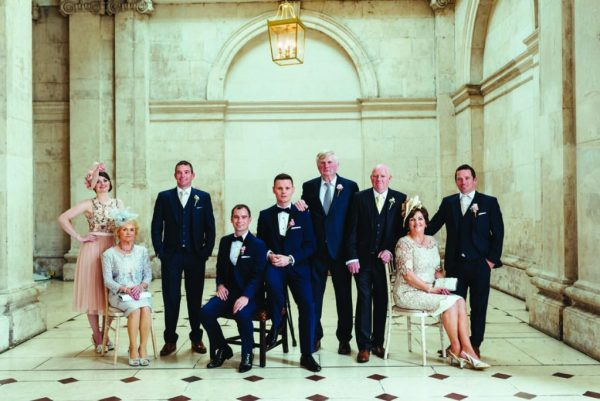 Andrew and thomas and their families in suits and dresses for their Real Weddings article