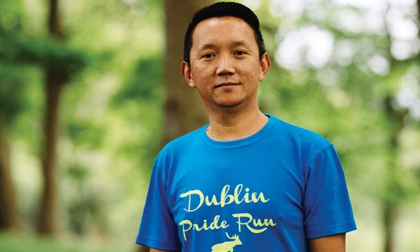 One of the Dublin Front Runners smiling and wearing a blue Dublin Pride Run T shirt