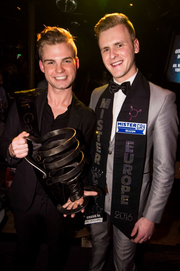 Stephen Lehane holding the MGI cup with the host as the winner of Mr Gay Ireland 2017