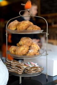 Scones and gingerbread men on a shelf at the cake cafe and slice which are both owned by Ray O'Neill