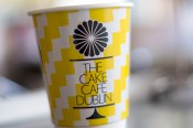 A yellow Cake Cafe Dublin coffee cup at the cake cafe and slice which are both owned by Ray O'Neill
