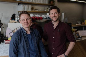 The two owner of Two Boys Brew café standing in shirts and smiling