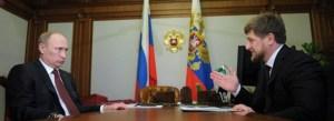 Putin and Chechnya's leader Ramzan Kadyrov sitting at a table as Kadyrov publicly denies gay purge again