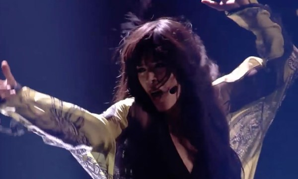 Loreen dancing in a chiffon jacket which is one of the costume ideas for GCN's Eurovision Douze Points Party