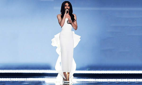 Conchita Wurst wearing a white dress which is one of the costume ideas for GCN's Eurovision Douze Points Party
