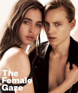 Two women holding each other on the cover of GCN Issue 332 with the words the female gaze written in front of them