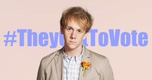 Josh Thomas standing in front of the hashtag #theygettovote
