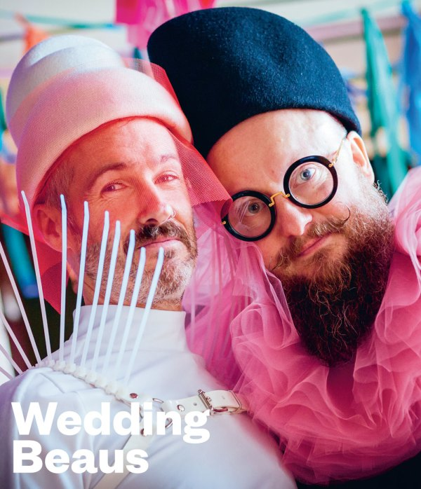 The two cover stars of the Wedding Beaus issue of GCN with a white leather spiky harness on one and round glasses and a hot pink ruffle collar