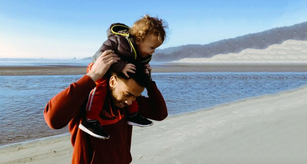A man with a child on his shoulders that he was able to adopt thanks to Ireland's new adoption (amendment) act 2017