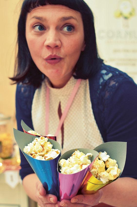 Ruth Ormiston from Cornude holding popcorn in colourful cones