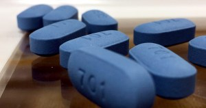 a picture of PrEP pills which are blue and have the number 701 written on them, the same drug that is manufactured by Gilead and known by it's name Truvada.