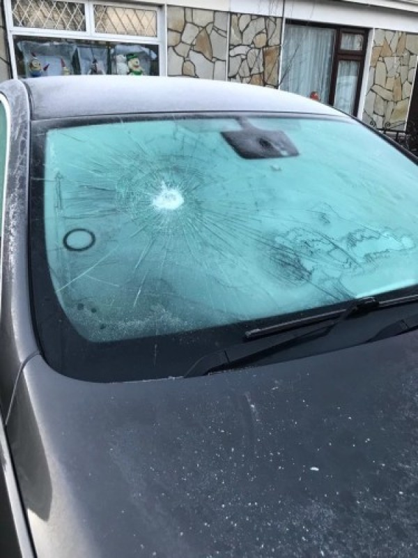 Photo showing damage to Timmons car windscreen, there is a big dent in the driver side as it was hit with a very heavy object.