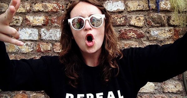 Una Mullally wearing sunglasses and a Repeal The 8th jumper