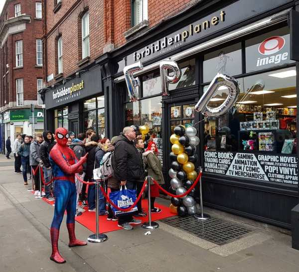 The queue outside Forbidden Planet Dublin on the launch party. A man dressed as Spider Man is pointing at the shop