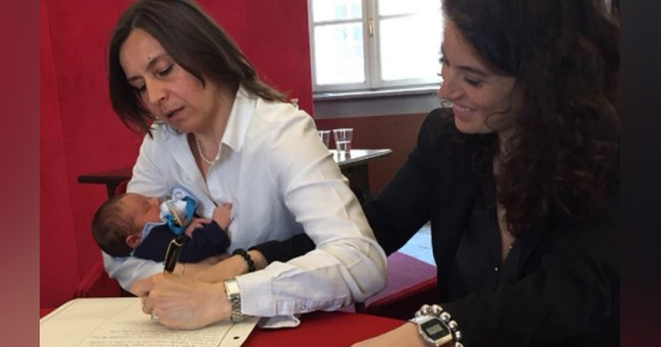 The couple register their son in Italy