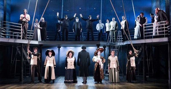 The cast from Titanic The Musical lined up across the deck of the ship