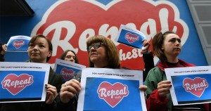 Women holding repeal signs