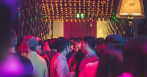 The gay club where the hen party wished to visit filled with men chatting and drinking