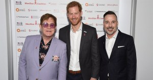 Elton John, Prince Harry and David Furnish pose together at the launch of MenStar Coalition