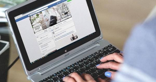 Someone accessing Facebook through their laptop