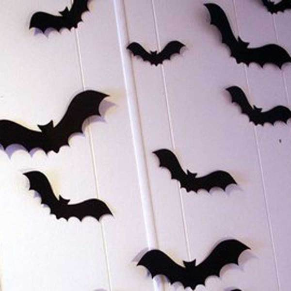 Bat silhouettes on a wall used as decoration for a Halloween party