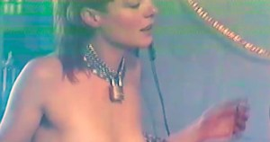 A still from Evvol's video 'Release Me', featuring a woman wearing a chain collar.