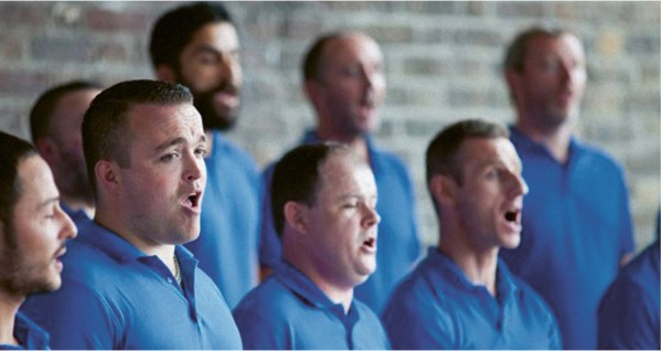 A group of men singing in a choir.