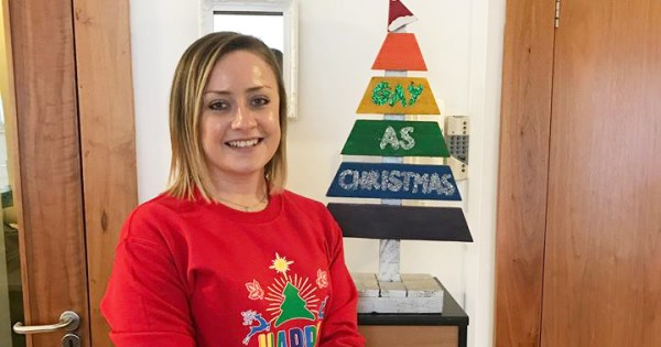 Mendicity's Head of Operations Katie Fitzsimons and our 'Gay as Christmas' tree.
