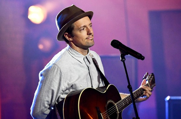 Jason Mraz performing with a guitar