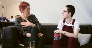Ailbhe Smyth and Emily O'Connell chat on a couch in an office