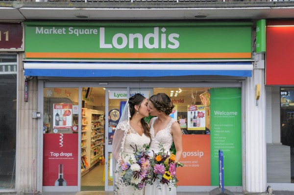 two women getting married outside londis