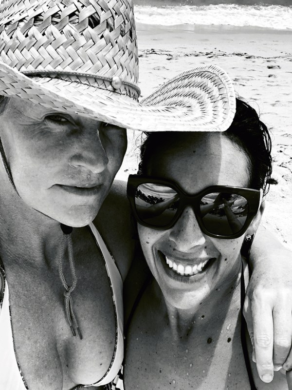 Fi Connors (right) wearing a hat and her partner Tina (left) wearing sunglasses