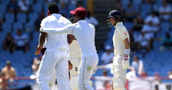 West Indies player Shannon Gabriels angrily confronts English cricket captain Joe Root at a match while another player holds him back