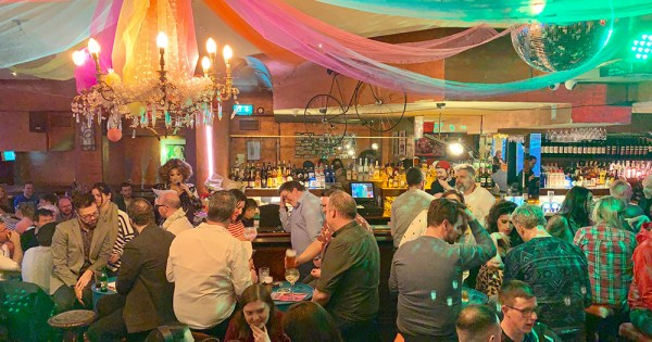 GCN's My Big Fat Gay Pub quiz filling a bar with quiz takers while drag queen Bunny asks questions