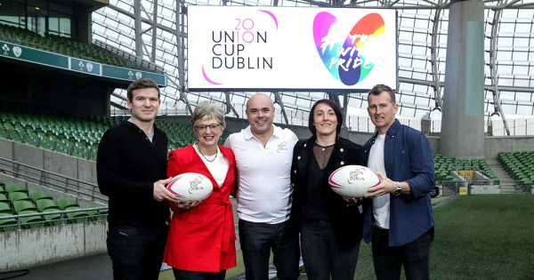 The Union Cup 2019 launch in the Aviva Stadium with Nigel Owens, Lindsay Peat, Katherine Zappone and two men posing on the pitch with rugby balls