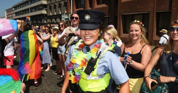A female member of the gardaí at Pride dressed in rainbow accessories
