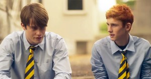 Handsome Devil characters Ned (Fionn O'Shea) and Conor (Nicholas Galitzine) sitting outside in school uniforms