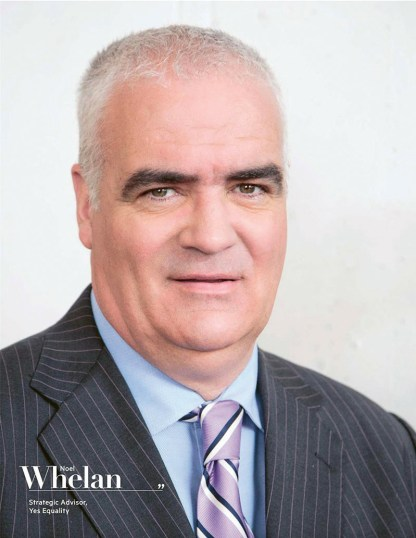 Noel Whelan in a suit against a white backdrop