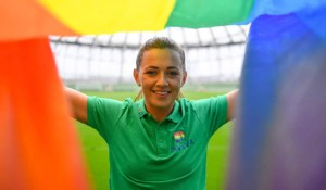 Katie McCabe holding up a rainbow pride flag in Aviva stadium