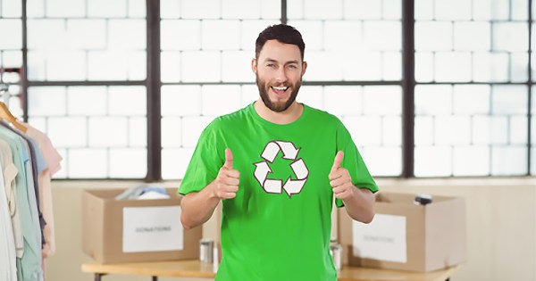 Man wearing recycling t-shirt doing double thumbs up