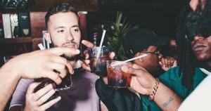 Friends clinking drinks in a bar
