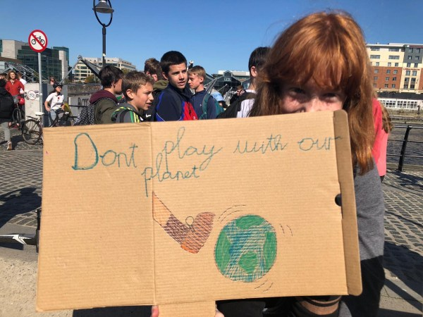 Young people holding signs as part of Dublin's contribution to the global climate protest.