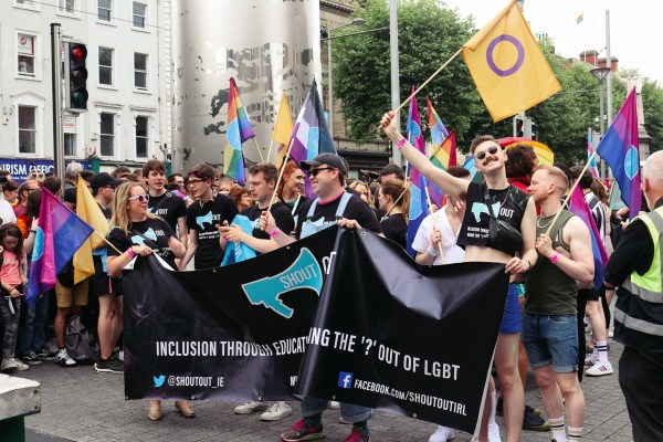 ShoutOut volunteers march behind banner in Dublin Pride parade 2019